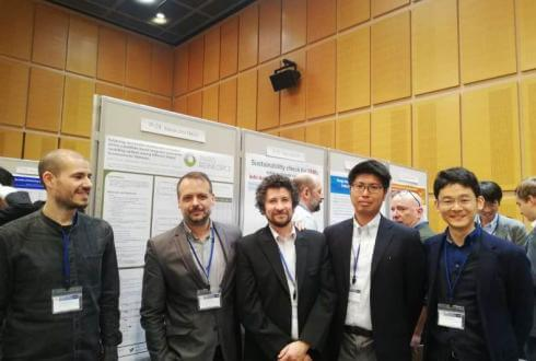 Alexandros Nikas and Haris Doukas discussing the PARIS REINFORCE poster with fellow researchers